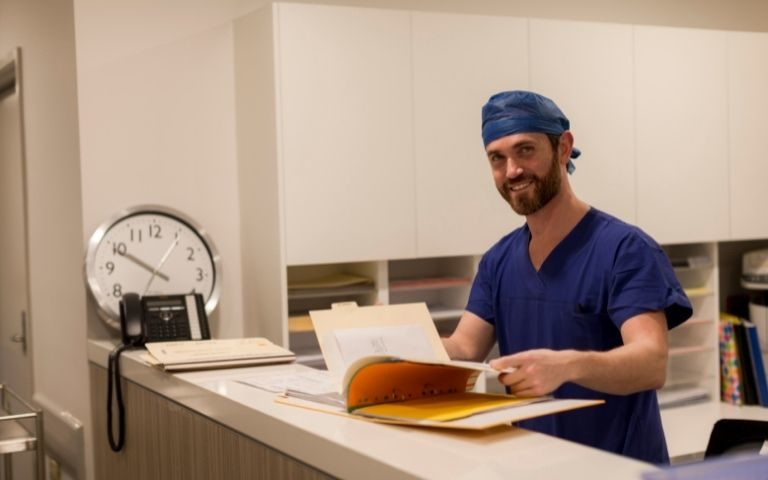 Male doctor smiling at the camera